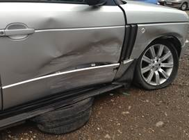 Close up of damaged Range Rover