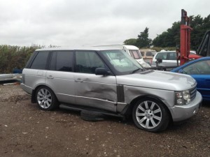 Range Rover with damage along drivers side of vehicle