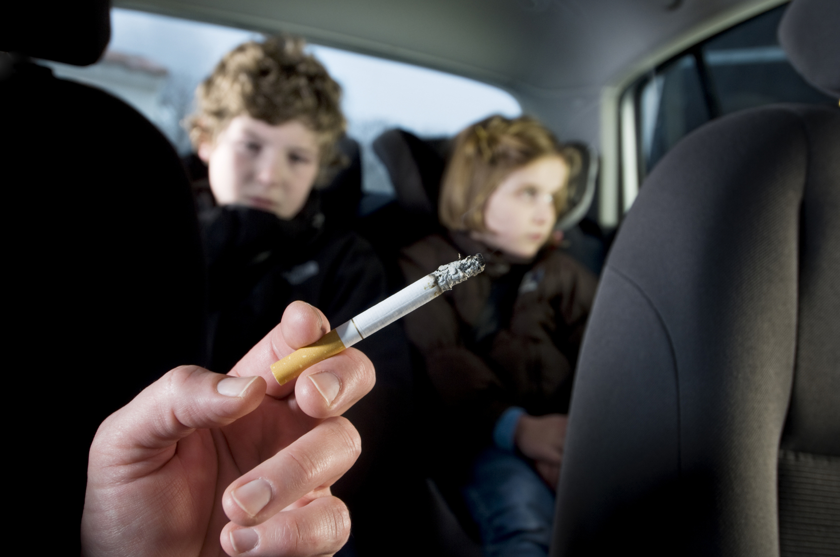 Children in a car passive smoking